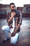 Good looking young arab man in casual clothes in urban environme Royalty Free Stock Photography