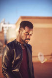 Good looking young black man in trendy clothes with negative spa Royalty Free Stock Images