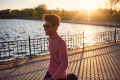 Good looking young black man in trendy clothes walking in morning Royalty Free Stock Photo