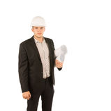 Good Looking Young Engineer Holding Blueprints. Good Looking Young Engineer in Black Attire Holding Blueprints Isolated on White Background Stock Photo