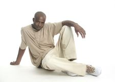 Good looking young man. Attractive young African American man sitting on the floor Royalty Free Stock Image