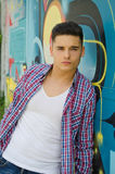 Good looking young man against graffiti wall Stock Photography