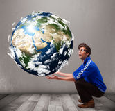 Good-looking man holding 3d planet earth Stock Photos