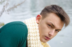 Good looking young man outdoors in nature (river, lake) Royalty Free Stock Photo