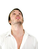 Handsome young man looking up Stock Images