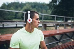 Young active handsome man in park stock image