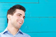 Good looking young man smiling and looking away Stock Photo