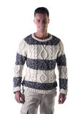 Good looking young man standing, wearing winter sweater Royalty Free Stock Image