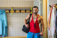 Good-looking young muscular man in gym dressing room Royalty Free Stock Photos