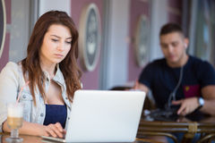 Good-looking young woman at a cafe Royalty Free Stock Photos