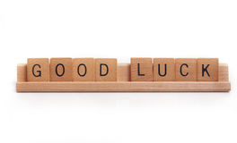 Good Luck. Photo of hand carved wooden tiles spelling out GOOD LUCK royalty free stock photography