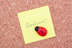 Good luck. Post it note on a cork stock photos