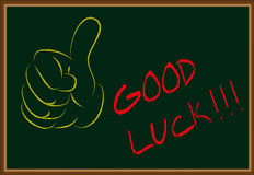 Good luck. Written in chalk on a black board Stock Photos