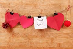 Good luck. Beautiful shot of good luck written on white chit with hearts stock photo