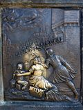 Good Luck Bronze Plaque, Charles Bridge, Prague. Brass plaque on statue on Charles Bridge, Prague, Czech Republic, rubbed shiny for good luck royalty free stock photo