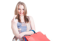 Good luck concept with young shopaholic holding finger crossed Royalty Free Stock Photos