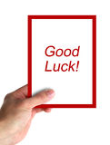 Good Luck. Hand holding a card with text Good Luck. isolated on white royalty free stock image