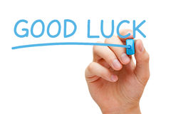 Good Luck. Hand writing Good Luck with blue marker on transparent wipe board stock image