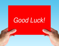Good Luck Note. Hand holding a red card with text Good Luck. isolated on white stock image