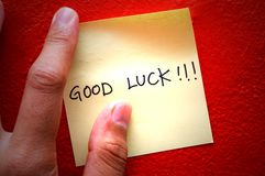 Good Luck Post-It Note. A Post-It note on the wall saying good luck royalty free stock image