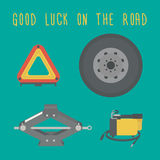Good luck on the road. A Jack, spare wheel, warning triangle, car air compressor. Royalty Free Stock Photo