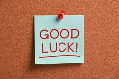 Good Luck !. Good Luck sticky note pinned on cork royalty free stock photo