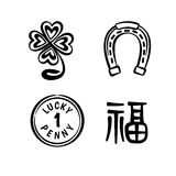 Good Luck Symbols. Four lucky symbols - four leaf clover, simple horseshoe, lucky penny and chinese characters Fu meaning Good Luck Royalty Free Stock Images