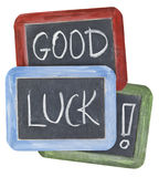 Good luck wishes on blackboard. Good luck wishes - white chalk handwriting on small slate blackboards with colorful wood frames royalty free stock photo
