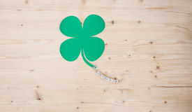 Good Luck. The words Good Luck and a cloverleaf on a cord on wood stock images