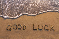 Good luck. Words written on the beach Stock Photo