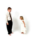 Good Manners. A gesture of respect or reverence made chiefly by women by bending the knees with one foot forward and lowering the body. Little girl faces her dad Royalty Free Stock Photo