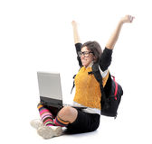 Good mark. Triumphing student with a laptop on her knees Stock Image