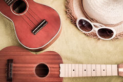 Good memory concept with ukulele and summer hat. In vintage color tone Royalty Free Stock Image