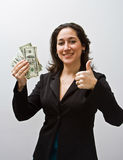 Good money. Business women thumbs up and holding money isolated on a white background royalty free stock photo