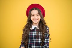 Good mood. fashionable school uniform. kid fashion. child on yellow background. parisian fashion girl. childrens day. Happy girl in french beret. small girl royalty free stock photos