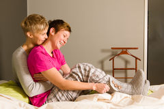 Good morning. Lesbian couple on a bedroom in the morning Royalty Free Stock Image