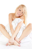 Good morning!. Blonde girl with pillow on the bed Stock Images
