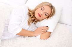 Good morning attractive young woman. Soon to wake up for sleeping attractive young woman on white bedroom Royalty Free Stock Photos