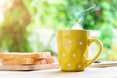 Good morning black coffee cup. And bread on a wooden table in the sunrise background. breakfast and wake up stock photos