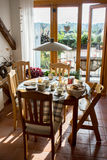 Good morning!. Breakfast table in the light of an sunny morning Stock Image