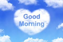 Good morning - cloud word. On blue sky background Royalty Free Stock Photo