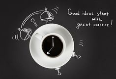 Good morning coffee and alarm clock concept. On black slate background, top view Royalty Free Stock Photos