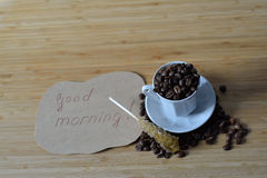 Good morning and coffee beans Stock Photo