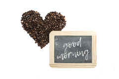 Good morning coffee. Heart made of coffee beans and blackboard with words good morning Stock Photos