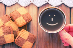 Good morning coffee smile cup. On wooden background and cookies Stock Photos