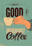 Good Morning! Coffee typographic vintage style grunge poster. Hand holds a coffee cup. Retro vector illustration. Royalty Free Stock Images