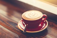 Morning coffee at windows on wooden table stock image