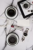 Good morning coffee with woman accessories with marble table top on a lazy sunday Stock Photo