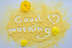 Good morning. Composition of the corn grits and chrysanthemums, gentle wish Good Morning. Still life Royalty Free Stock Photo