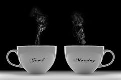 Good Morning. Morning Concept with Two Cups of Warm Coffee Against Black Background Royalty Free Stock Photo